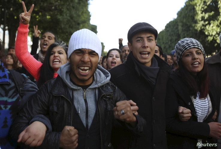 Unemployed graduates shout slogans during a demonstration to demand the government provide them with job opportunities, on Habib Bourguiba Avenue in Tunis, Tunisia, Jan. 20, 2016.
