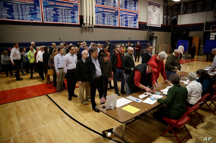 Voters line up to vote at a polling place in Doylestown, Pa., Nov. 6, 2018.