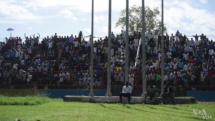 Spectators cheer for their one of four teams from different tribes as they compete for prizes and bragging rights.