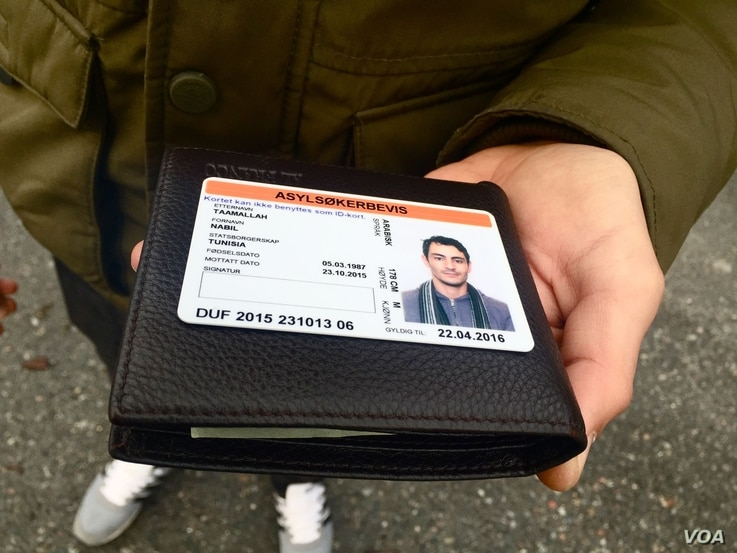 Nabil, a Tunisian who moved to St. Petersburg after terrorist attacks destroyed the Tunisian tourism industry, holds his 6 month temporary visa to Norway.