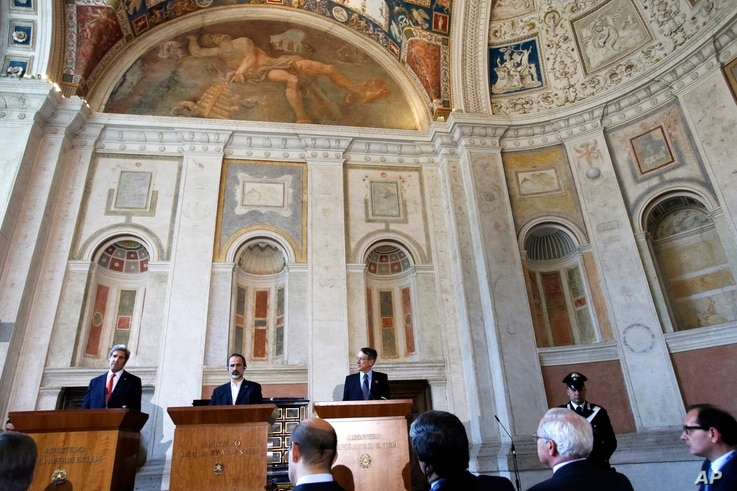 U.S. Secretary of State John Kerry holds a news conference with Syrian National Coalition Chairman Mouaz al-Khatib and Italian Foreign Minister Giulio Terzi at Villa Madama in Rome, Feb. 28, 2013.