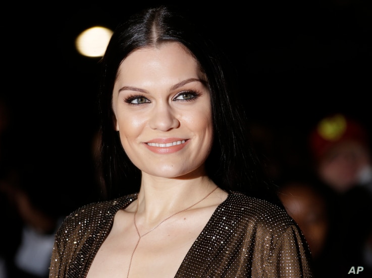 Jessie J poses for photographers upon arrival at the Mobo Awards, in central London, Oct. 22, 2014.
