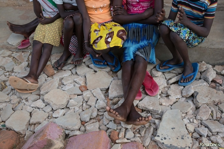 Girls sit in the yard at Kalas Girls Primary School, Amudat District, Karamoja, Uganda, Jan. 31, 2018. They each escaped home after their families tried to force them to undergo FGM or to enter into marriage.