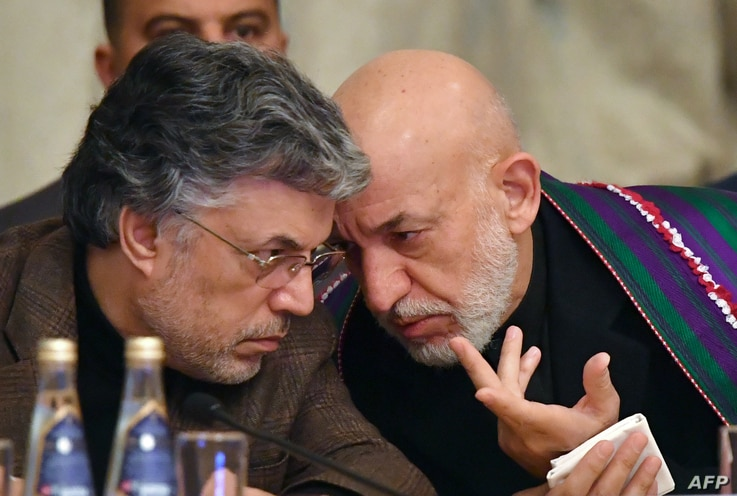 Former Afghan president Hamid Karzai attends the opening of two-day talks between Taliban and Afghan opposition representatives, at the President Hotel in Moscow, Russia, Feb. 5, 2019.