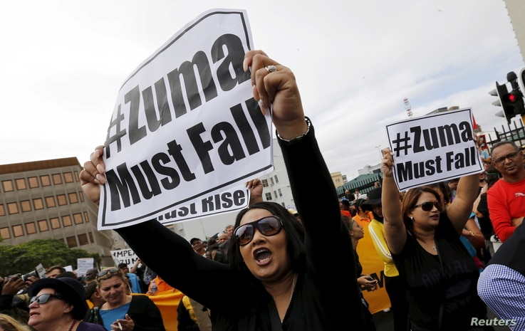 Protesters call for the removal of South Africa's President Jacob Zuma as the country commemorates the anniversary the country's first democratic elections in Cape Town, April 27, 2016.
