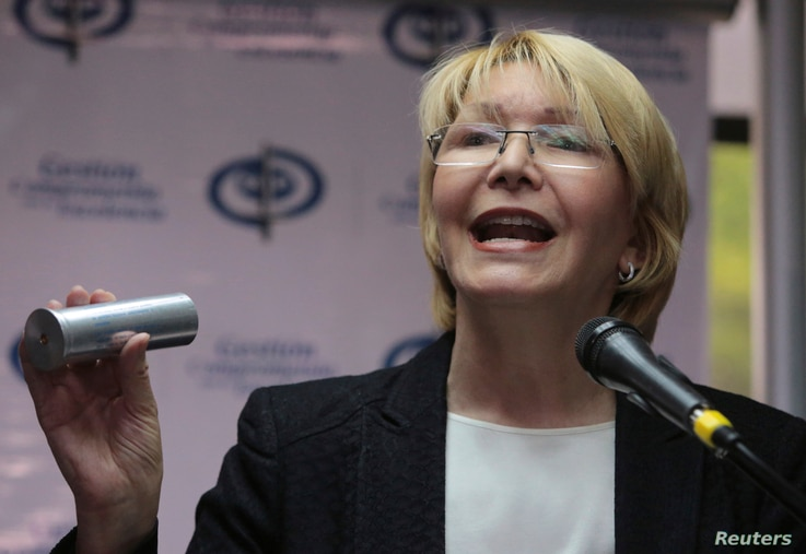 Venezuela's Chief Prosecutor Luisa Ortega Diaz holds up the kind of tear gas canister used by security forces to disperse anti-government protests, as she speaks to the press at her office in Caracas, Venezuela, May 24, 2017. Ortega explained that t...