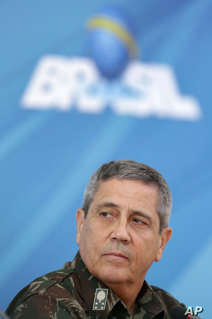 General Walter Souza Braga Netto speaks during a press conference after signing a decree for the military intervention of Rio de Janeiro's local police, Feb. 16, 2018.