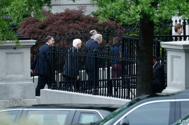 Senate Majority Leader Mitch McConnell., center, and other senators walk to an all-Senators briefing on the situation in the Korean Pensinsula, April 26, 2017, at the Eisenhower Executive Office Building on the White House complex in Washington.