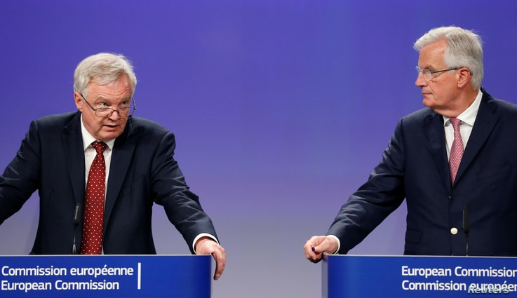 Britain's Secretary of State for Exiting the European Union David Davis and European Union's chief Brexit negotiator Michel Barnier hold a joint news conference after a round of Brexit talks in Brussels, Belgium, July 20, 2017.