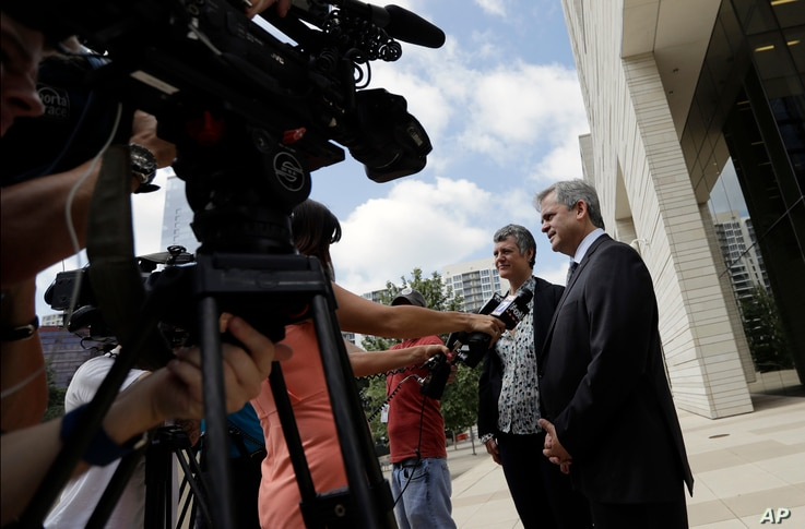 """Austin Mayor Steve Adler, right, and Travis County Judge Sarah Eckhardt talk with reporters outside the federal courthouse, June 29, 2017, in Austin, Texas. A new Texas """"sanctuary city"""" ban is back in court as the state asks a federal judge to approv..."""