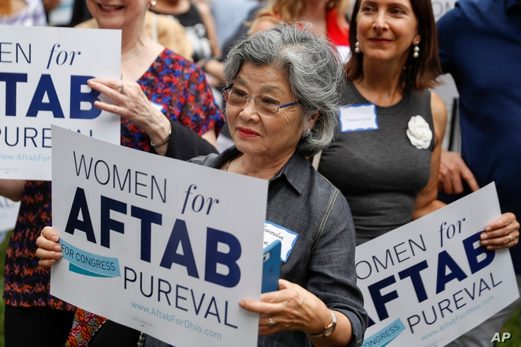 """FILE - Supporters gather to listen to former U.S. Rep. Gabby Giffords and Hamilton County Clerk of Courts Aftab Pureval speak during the """"Women for Aftab"""" advocacy group kickoff event in support of Pureval's 1st House District challenge to veteran Re..."""