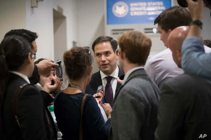 Sen. Marco Rubio, R-Fla., arrives for party policy meetings regarding the Senate Republican health care bill at the Capitol in Washington, June 27, 2017.