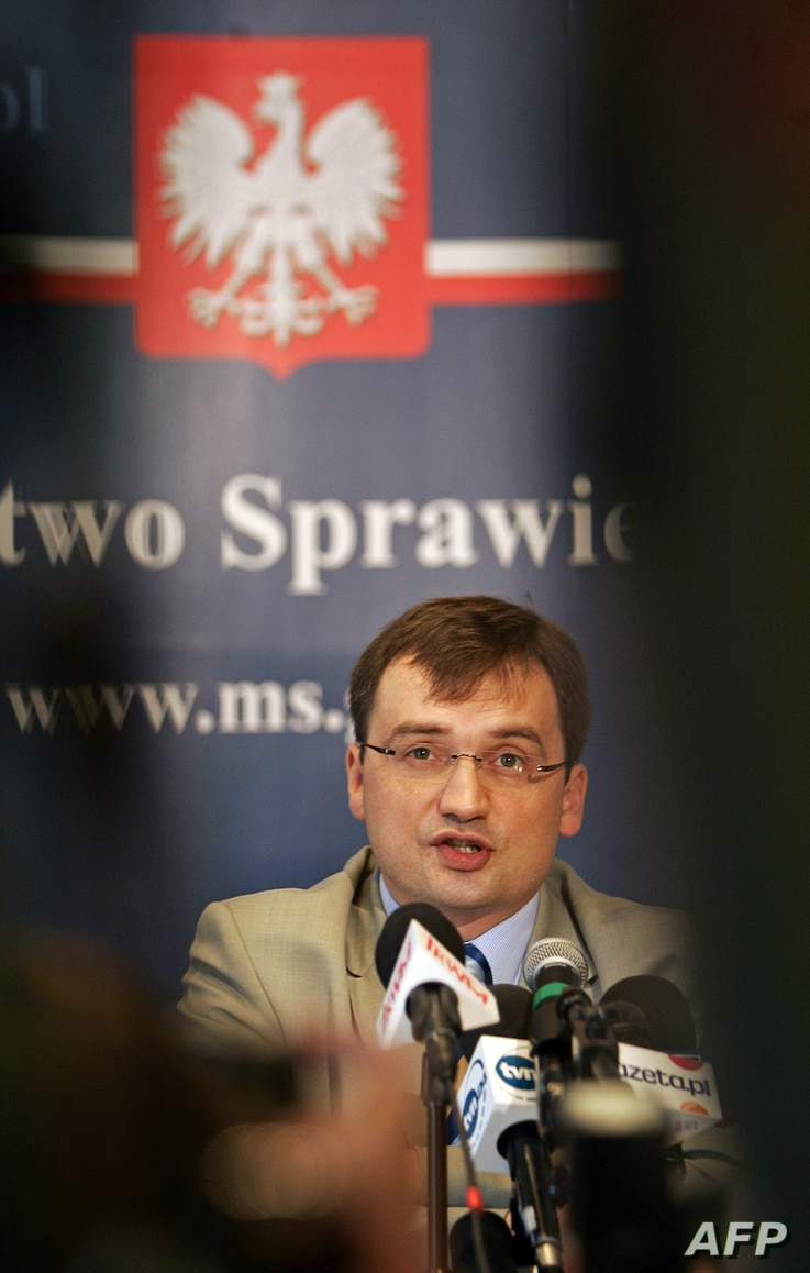 FILE - Polish Justice Minister Zbigniew Ziobro listens to a question during a press conference in Warsaw. On July 12, 2017, he criticized the current makeup of the National Judiciary Council as undemocratic.
