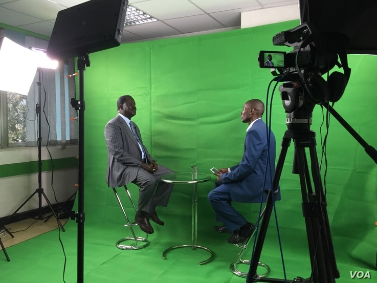 Former Kenyan prime minister and current opposition leader Raila Odinga speaks with VOA Swahili reporter Kennedy Wandera and Jill Craig in the new VOA studio about recent protests and anti-electoral commission sentiment among his supporters, Nairobi,...