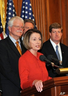 Nancy Pelosi joins fellow Democrats after the historic passage of the health care reform bill.