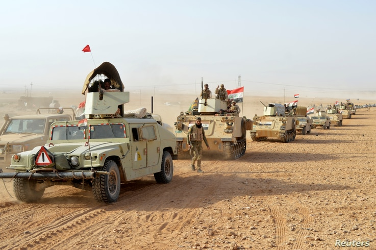 Iraqi forces' vehicles are seen after the fighters captured Rawa town, the last remaining town under Islamic State control, Nov. 17, 2017.