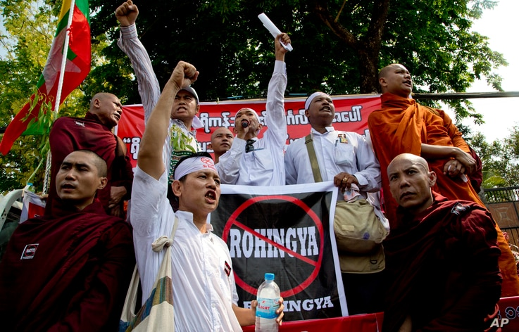 "Members of a Buddhist nationalist group shout slogans during a protest outside U.S. Embassy in Yangon, Myanmar against the embassy's April 20, 2016 statement with the word ""Rohingya"" Thursday, April 28, 2016."