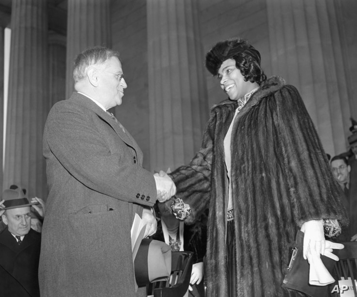 American contralto, Miss Marian Anderson, right, is shown with Secretary of Interior Harold Ickes before a concert on the steps of Lincoln Memorial in Washington, D.C. on Easter Sunday, April 9, 1939.
