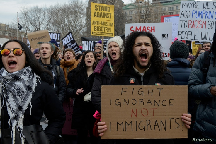 People participate in a protest against U.S. President Donald Trump's immigration policy and the recent Immigration and Customs Enforcement (ICE) raids in New York City, on Feb. 11, 2017.