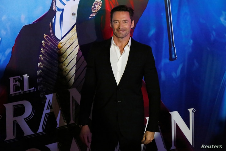 """Actor Hugh Jackman poses for photographers on the red carpet for his latest film, a musical directed by Michael Gracey called """"The Greatest Showman,""""  in Mexico City, Dec. 13, 2017."""