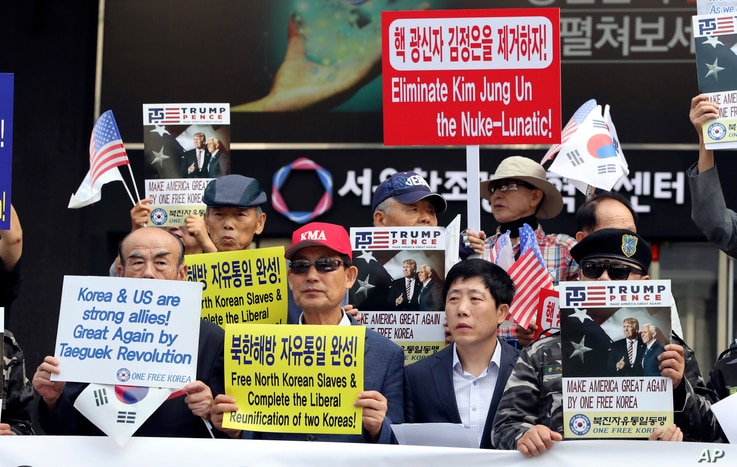 South Korean conservative activists and North Korean defectors hold a rally against North Korea and North's leader Kim Jong Un in downtown Seoul, South Korea, Sept. 8, 2017. South Korea is closely watching North Korea over the possibility it may laun...