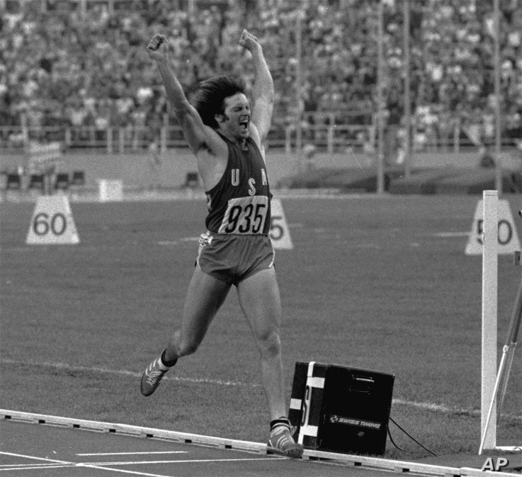 FILE - California's Bruce Jenner leaps jubilantly in the air after securing gold in the Olympic Decathlon in Montreal, Canada, July 30, 1976.