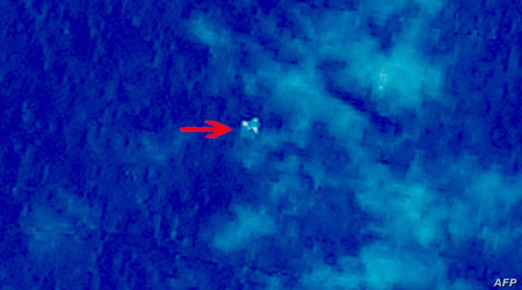 """Handout photo provided by China Center for Resources Satellite Data and Application shows  satellite image taken from space, illustrating objects in a """"suspected crash sea area"""" in the South China Sea on March 9, 2014, thought to possibly be from the..."""