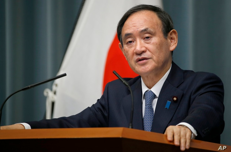 FILE - Japan's Chief Cabinet Secretary Yoshihide Suga speaks to the media during a press conference at the prime minister's official residence in Tokyo.