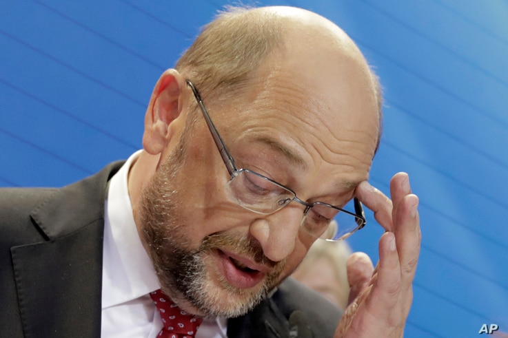 Party chairman and top candidate Martin Schulz addresses his supporters in the headquarters of the Social Democratic party in Berlin, Germany, Sept. 24, 2017, after the polling stations for the German parliament elections had been closed. The sign re...