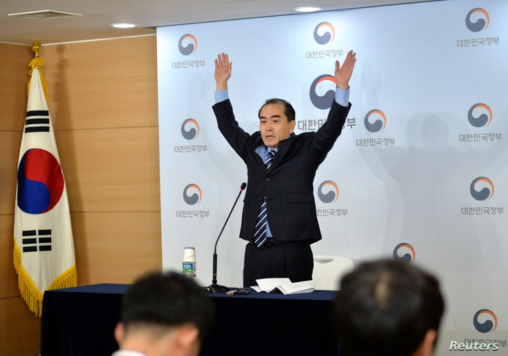 Thae Yong Ho, the former North Korean deputy ambassador to London, cheers during a news conference at the Government Complex in Seoul, South Korea, Dec. 27, 2016.