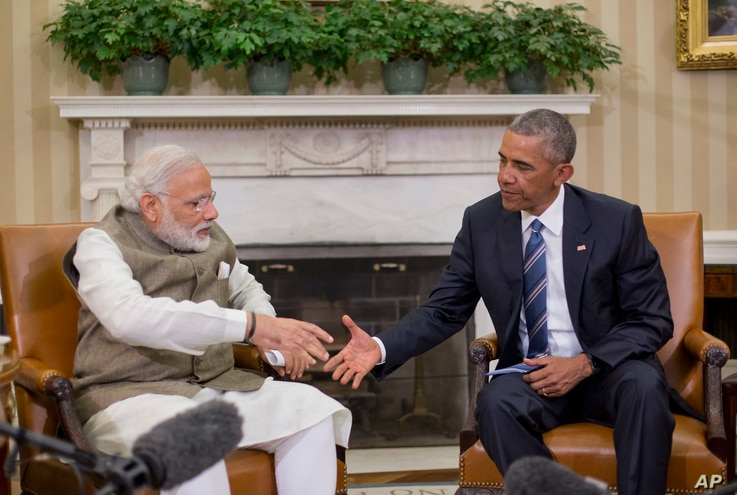 President Barack Obama reaches to shake hands with Indian Prime Minister Narendra Modi during their meeting in the Oval Office of the White House in Washington, June 7, 2016.