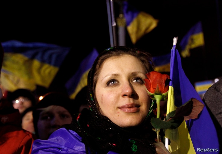 Pro-European integration protesters attend a rally at Independence Square in Kyiv, December 8, 2013.