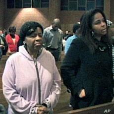 Haitian-Americans attend mass at St. Camillus Catholic Church in Silver Spring, Maryland to support grieving Haitians, 17 Jan 2010