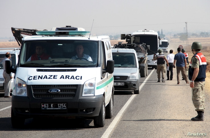 A funeral transport vehicle (front) carrying the bodies of drowned Syrian migrants, including three-year old boy Aylan Kurdi, drives to the Turkish-Syrian border in Suruc, bordering with the northern Syrian town of Kobani, Turkey, Sept. 4, 2015.