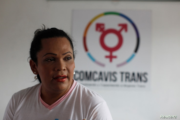 Karla Avelar, executive director of the Association for Communicating and Training Trans Women, poses for a picture at her office in San Salvador, El Salvador, May 12, 2017.