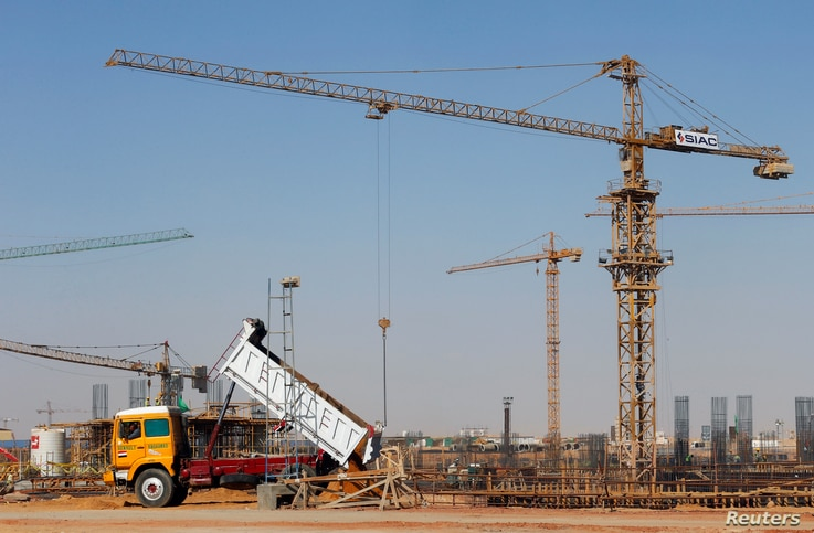 FILE - Constructions machines and workers are seen in Egypt's new administrative capital, north of Cairo, Egypt, Oct. 18, 2017.