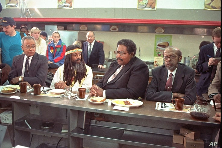The four black men who were denied service at the Woolworth store in Greensboro, NC thirty years ago, take their places at the same lunch counter to recreate their sit-in, February 2, 1990.