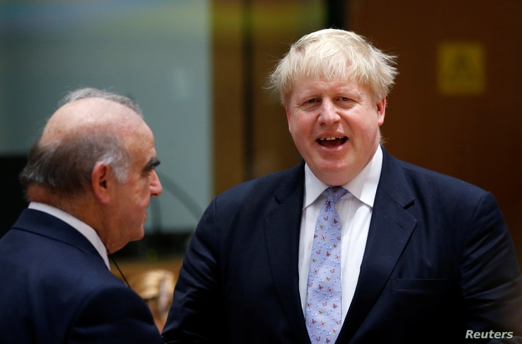 Britain's Foreign Secretary Boris Johnson talks to Malta's Foreign Minister George Vella, (left) during a European Union foreign ministers meeting in Brussels, Belgium, January 16, 2017.