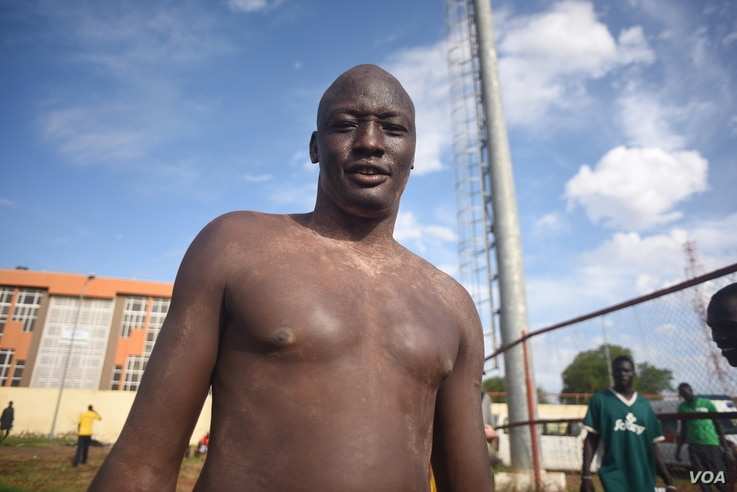"A Mundari wrestler stands with ash on his body before the ""Wrestling for Peace"" tournament at Juba Stadium in South Sudan's capital, April 16, 2016. (J. Patinkin/VOA)"
