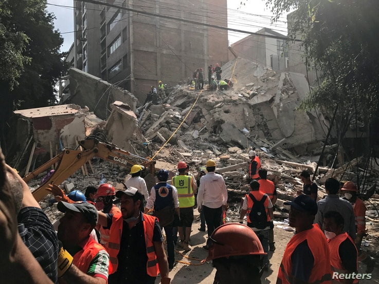 People clear rubble after an earthquake hit Mexico City, Mexico, Sept. 19, 2017.