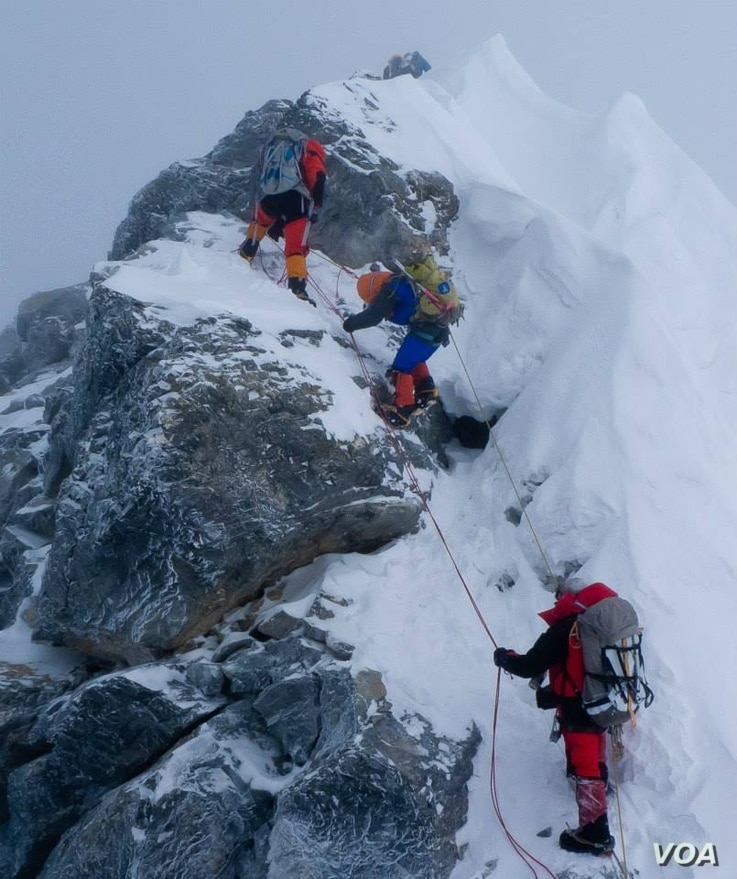 Alison Levine (in blue) on her way up Mount Everest.
