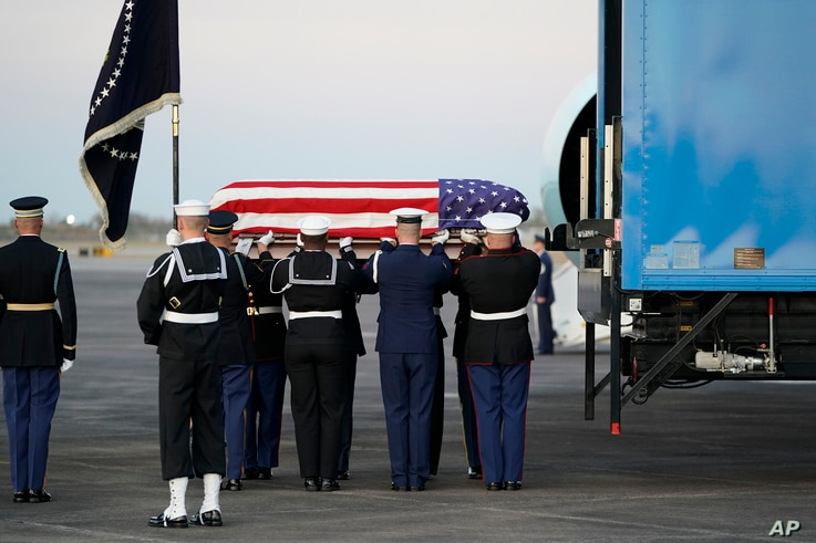 The flag-draped casket of former president George H.W. Bush is carried by a joint services military honor guard, Dec. 5, 2018, at Ellington Field in Houston, Texas.