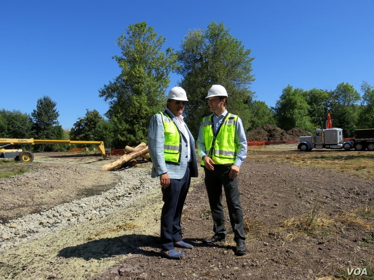 Aegis Living CEO Dwayne Clark (left) and development manager Brian Palmore at the future location of the Chinese-themed retirement home Aegis Gardens in Newcastle, Washington.