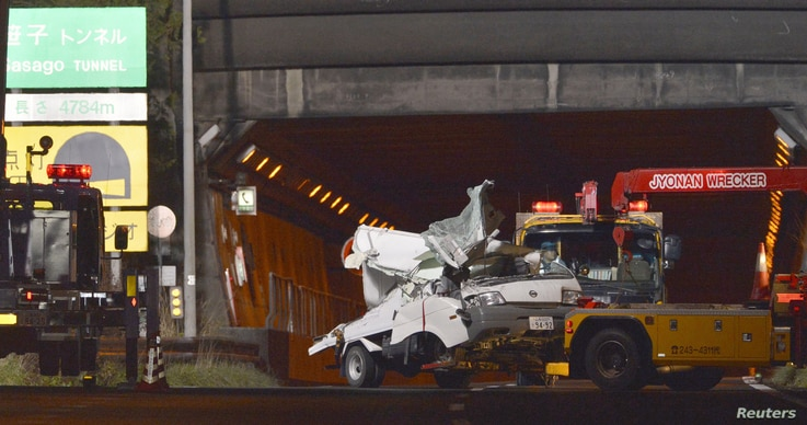 A damaged truck is towed away from the Sasago Tunnel on the Chuo Expressway, after being trapped in a collapsed tunnel the previous day, in Koshu, Yamanashi prefecture, in this photo distributed by Kyodo, December 3, 2012.