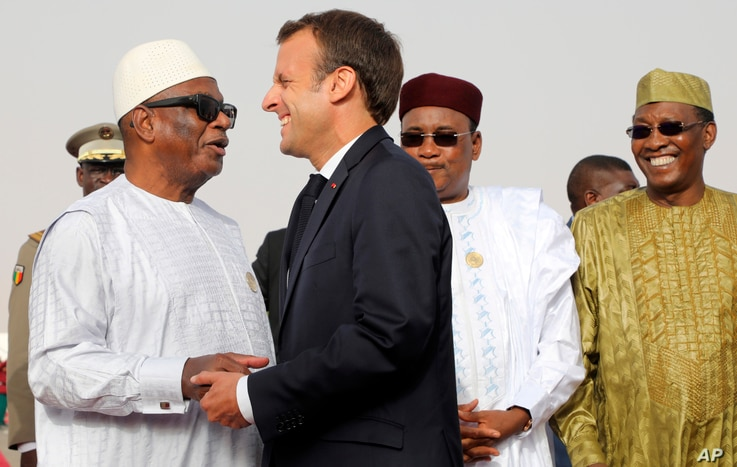 In this pictured taken July 2, 2018, Mali's President Ibrahim Boubacar Keita, left, embraces French President Emmanuel Macron as Niger President Mahamadou Issoufou, 2nd right, and Chad's President Idriss Deby, right, look on before a working session ...