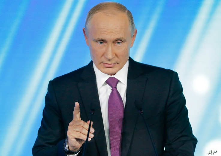 Russian President Vladimir Putin gestures speaking at a meeting of the Valdai International Discussion Club in Sochi, Russia, on Oct. 19, 2017.