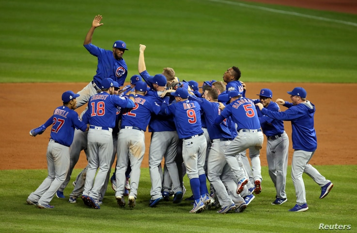 Chicago Cubs players celebrate after defeating the Cleveland Indians in game seven of the 2016 World Series in Ceveland, Ohio, Nov. 2, 2016.