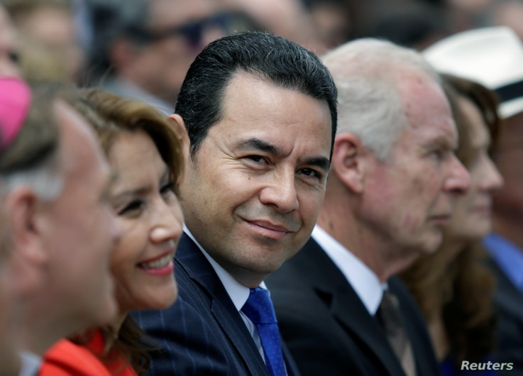 Guatemala's President Jimmy Morales (C) attends the inauguration of the Spanish Square in Guatemala City, Guatemala, Sept. 12, 2017.