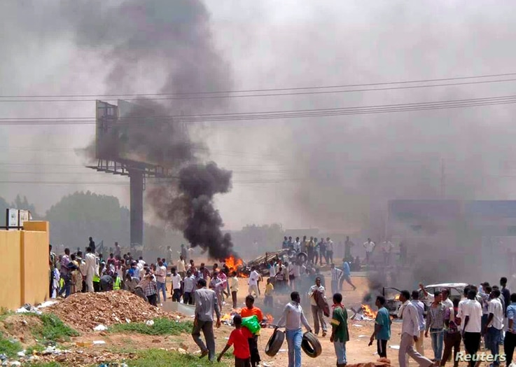 People take part in protests over fuel subsidy cuts in Khartoum September 25, 2013. At least 27 people have been killed in protests in Khartoum over fuel subsidy cuts, a medical source said on Thursday as another bout of the worst unrest seen in Suda
