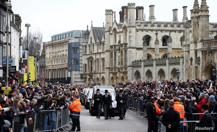 The funeral cortege arrives at Great St. Mary's Church for the funeral of theoretical physicist Stephen Hawking, in Cambridge, Britain, March 31, 2018.